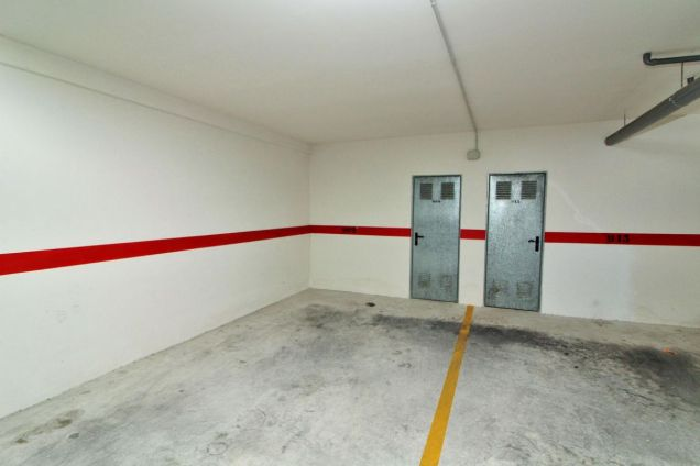 Private secure parking space and large storage room included