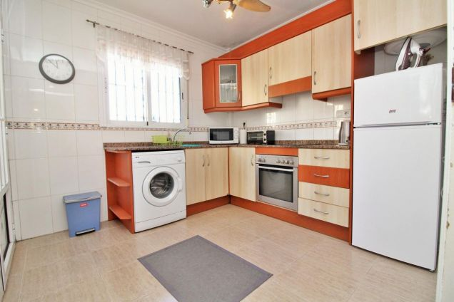 Fully fitted kitchen with white goods