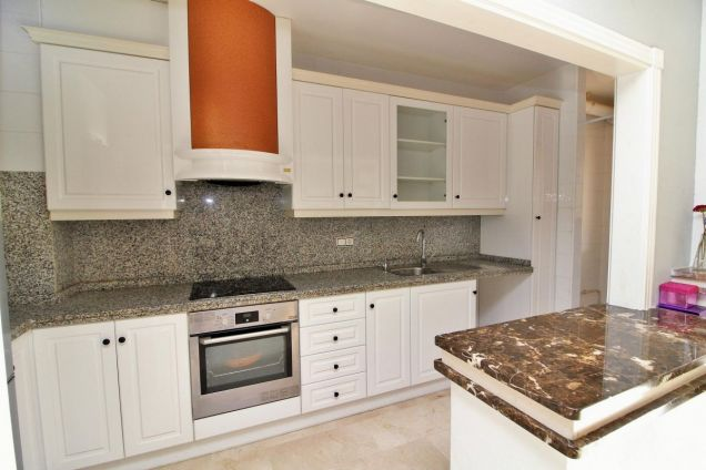 American style kitchen with utility room
