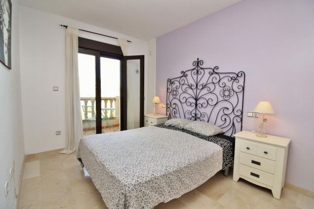 Master bedroom with Julliet balcony with golf views